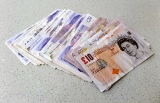 Pound plunges as UK ministers quit over Brexit deal