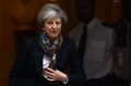 May slams Russia's new domestic violence law as 'retrograde'